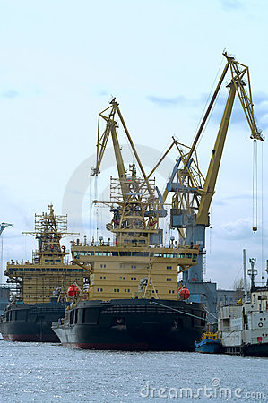 Several ships and harbour cranes