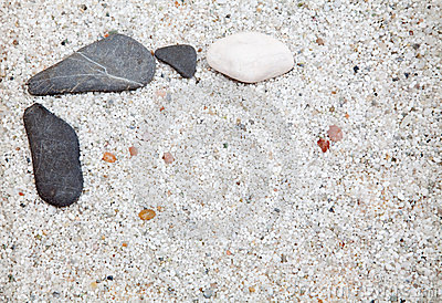 Several stones on sand.
