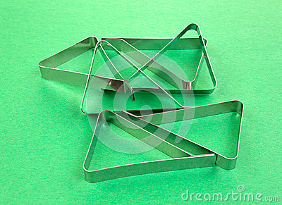 Several tablecloth clamps on green background