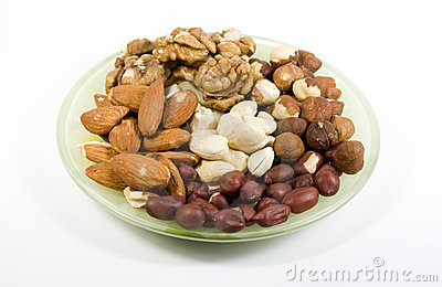 Several types nuts on saucer