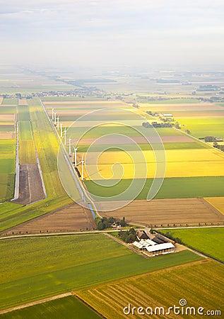 Several windmills and farm at Dutch landscape