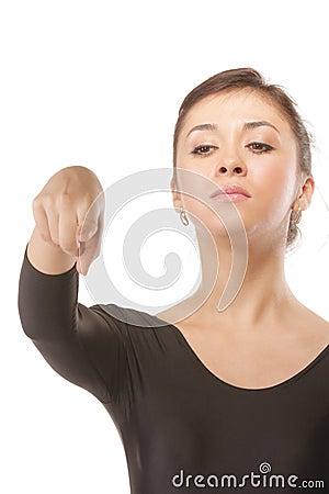 Severe dance teacher pointing forefinger down
