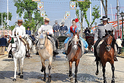 SEVILLE, SPAIN, riders mounted on horses by the fa Editorial Photo