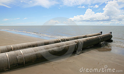 Sewage pipe draining into the ocean