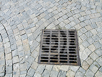 Sewer cover at paved stone