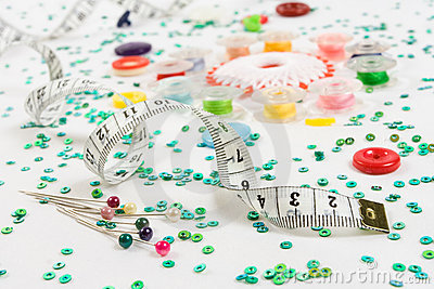 Sewing background: buttons, ruler, needles