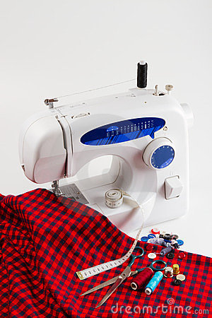 Sewing machine with red cloth