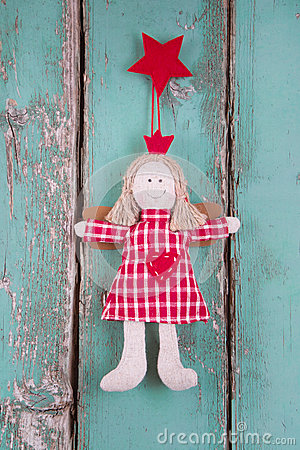 Free Sewn Angel Doll Hanging On Turquoise Wood Board - Christmas Stock Photos - 34489213
