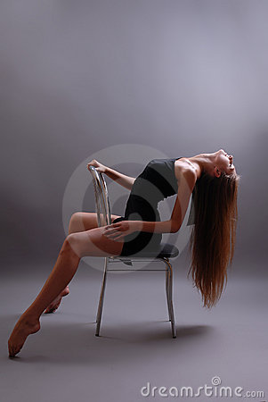 Free Sexual Young Girl On A Chair Royalty Free Stock Photography - 15734717
