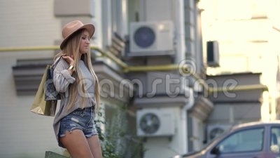 Sexually dressed woman walking out from shop stock footage