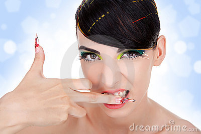 Sexy aggressive woman biting her middle finger