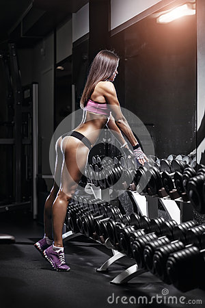 Free Sexy Athlete With A Dumbbell In The Gym Lean On Dumbbell Row Royalty Free Stock Photo - 50023895