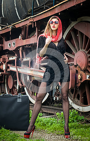 Sexy attractive girl waiting for landing on the platform in the vintage train