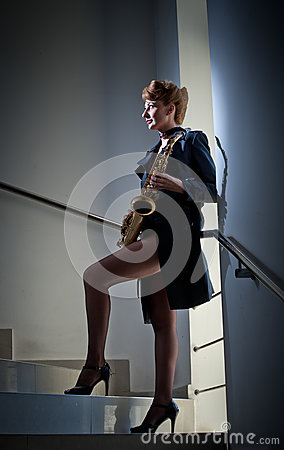 Free Sexy Attractive Woman With Saxophone And Long Legs Posing On Stairs. Young Attractive Blonde Playing Sax. Musical Instrument. Jazz Stock Photography - 83363282