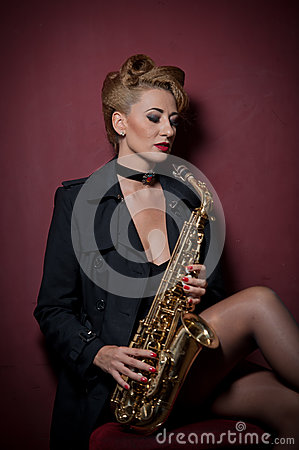 Free Sexy Attractive Woman With Saxophone Posing On Red Background. Young Sensual Blonde Playing Sax. Musical Instrument, Jazz Stock Images - 83383314