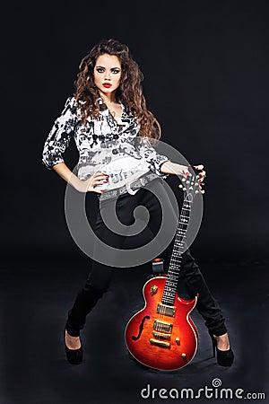 Sexy beautiful girl with sunburst electric guitar
