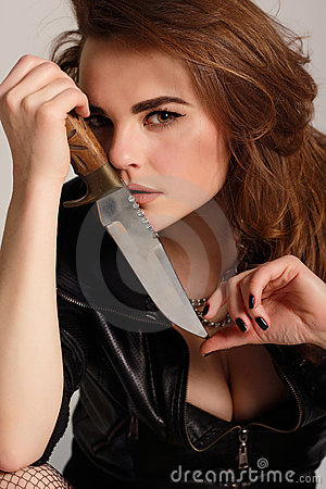 Sexy beautiful woman with knife