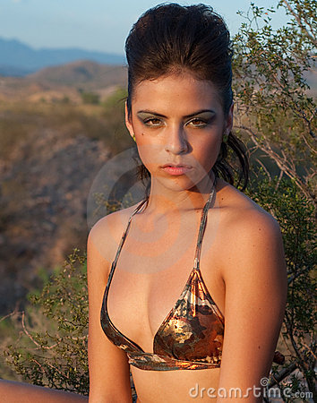 Sexy beautiful woman in wild desert landscape