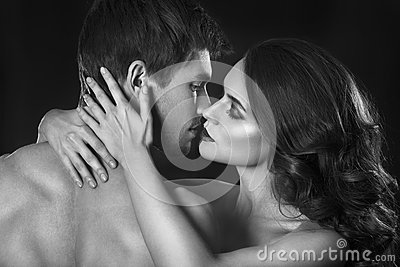 Sexy beauty couple.Kissing couple portrait.Sensual brunette woman in underwear with young lover, passionate couple Stock Photo