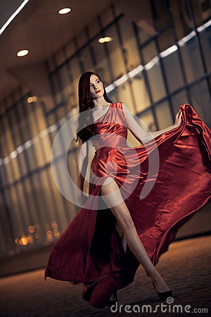 Free Sexy Beauty Woman In Fluttering Red Dress Royalty Free Stock Photography - 25253797
