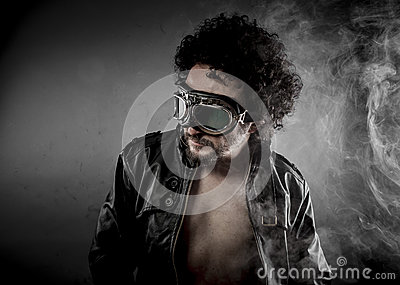 Sexy biker with sunglasses era dressed Leather jacket, huge smok