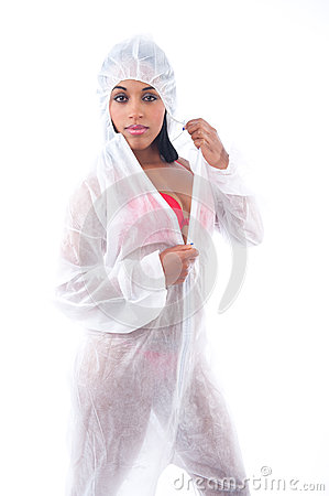 Sexy black woman in white protective suit