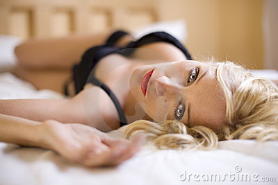 Sexy blond girl on the bed