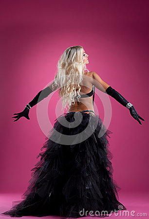 Sexy blond woman dance in oriental costume on rose
