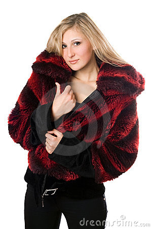 Sexy blond woman in a fur jacket