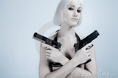Sexy blond woman with guns