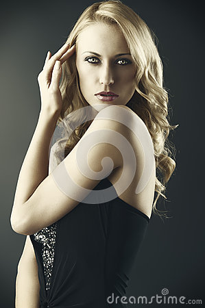 Sexy blond woman with hand near the hair