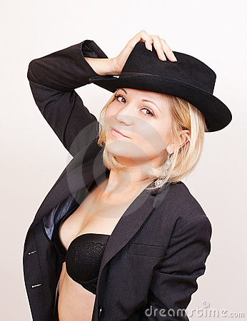 Sexy blond woman in hat and jacket on white