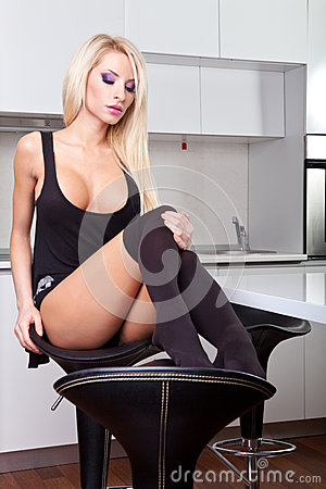 Sexy blond woman in kitchen