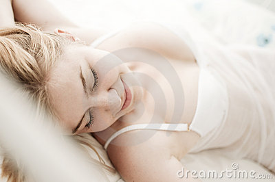 Sexy blond woman sleep on bed