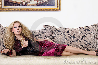 Sexy blond woman on the sofa
