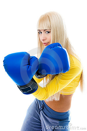 Sexy blond woman wearing boxing gloves