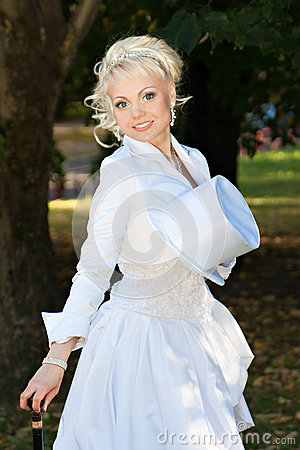 Sexy blonde bride in the park