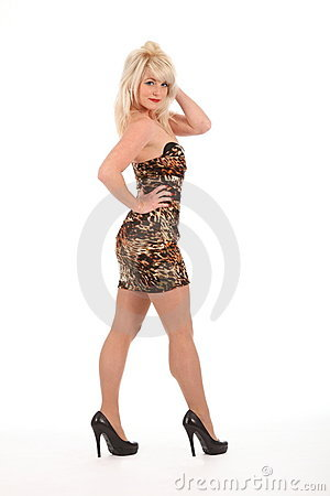 Sexy blonde girl in high heels and short dress
