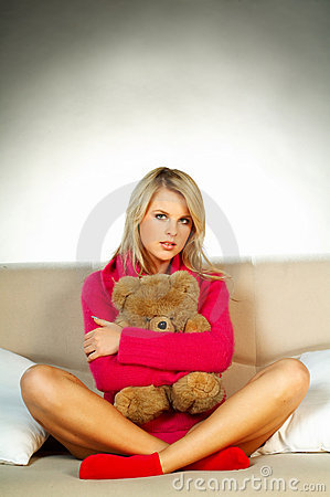 Sexy blonde girl with teddy bear
