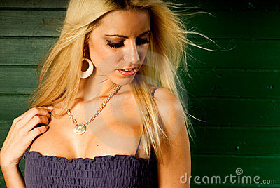 Sexy blonde woman fashion model showing cleavage
