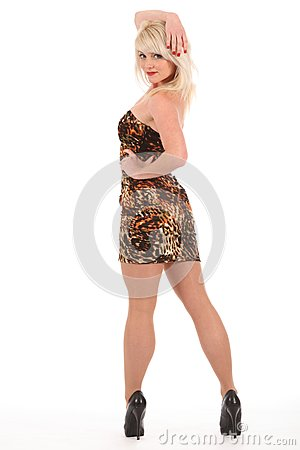 Sexy blonde woman in high heels and short dress