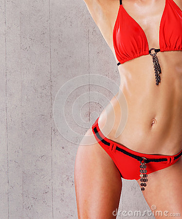 Sexy body of a woman posing in a red swimsuit