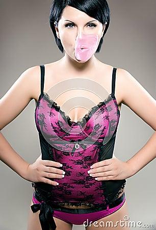 Sexy brunette with bubblegum