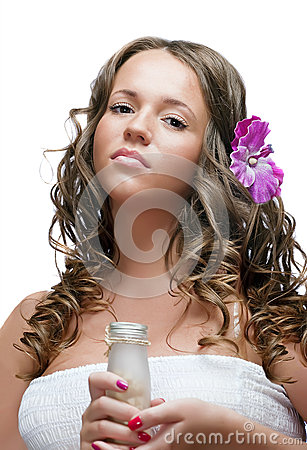 Sexy  brunette girl with SPA cosmetics