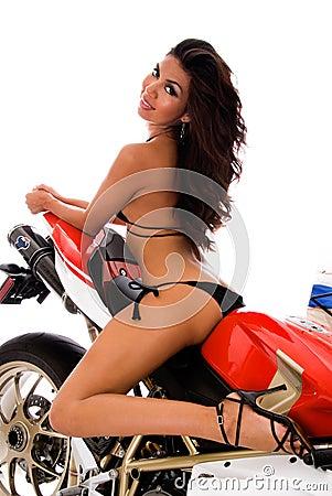 Sexy brunette on motorbike
