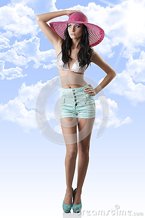 Sexy brunette with shorts and hat