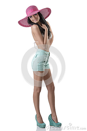 Sexy brunette with shorts and hat, she laughs