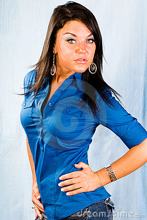 Sexy brunette woman fashion model in blue shirt