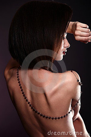 Sexy brunette woman with jewelery