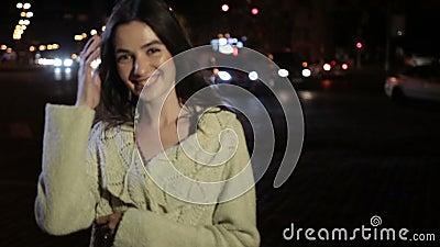 brunette woman posing on night city street stock video
